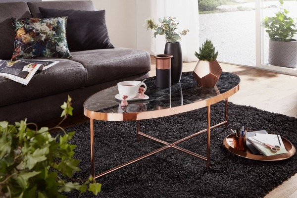Design  Hinreissender Couchtisch im modernen Stil Ovale Tischplatte auf einem filigranen Metallgestell Abmessungen  Breite: 110 cm Hoehe: 40 cm Tiefe: 56 cm Glasplatte (B x T) : 109 x 55 cm Tischplattenstaerke: 0,5 cm Tischrandstaerke: 3,5 cm Farbe