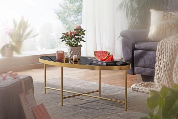 Design  Entzueckender Couchtisch im eleganten, modernen Stil Ovale Tischplatte auf filigranem Metallgestell Abmessungen  Breite: 110 cm Hoehe: 40 cm Tiefe: 56 cm Tischplatte (B x T): 109 x 55 cm Tischrandstaerke: 3,5 cm Abstand vom Boden bis zur Tisc