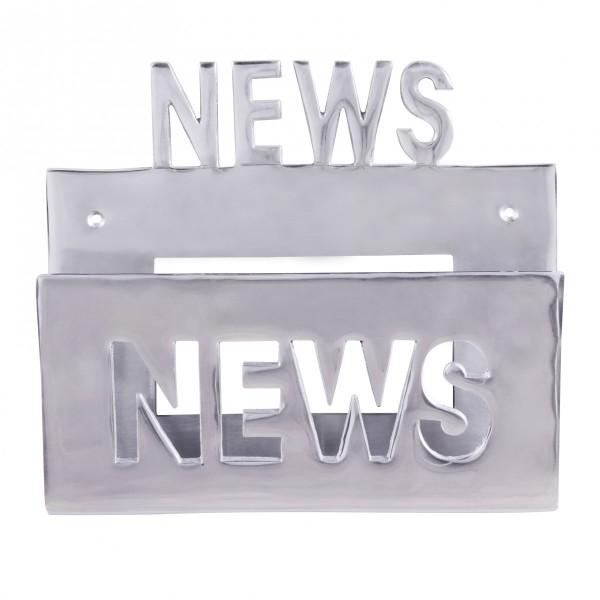 Design  Ein echter Blickfang: Ein Deko Zeitungshalter aus Aluminium Schriftzug News - optisches Highlight Hochwertige Verarbeitung Grosses Ablagefach Abmessungen  Breite: 30 cm Hoehe gesamt: 27 cm Tiefe Ablagefach: 7 cm Abstand zwischen Loechern: 24,