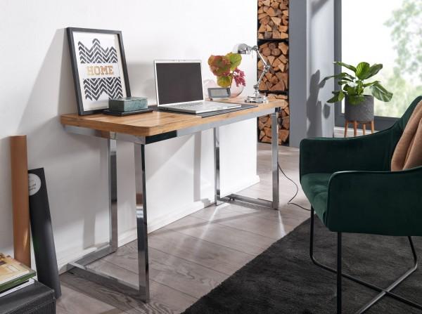 Design  Moderner Schreibtisch im extravaganten Look Grosszuegige Ablageflaeche fuer angenehmes Arbeiten Konisch verlaufende Schreibtischplatte mit integrierter Unterlage Verchromte Tischbeine als optimaler Kontrast zur Tischplatte mit Eichendekor Abm